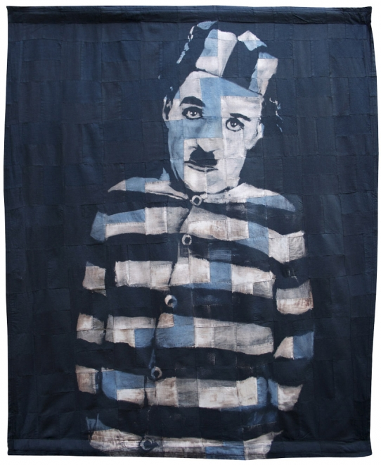 Chaplin : 2011, Portrait of Charlie Chaplin. Ink, dye & bleaching technique on antique 1920s patchwork handmade quilt. Fabric size 937 x 1117 mm, box frame approx 1077 x 1257 mm.